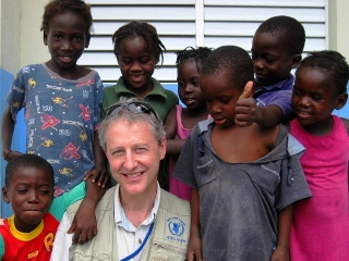 Patrick Webb in Haiti with local children
