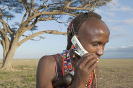 Masai herdsman on a cell phone